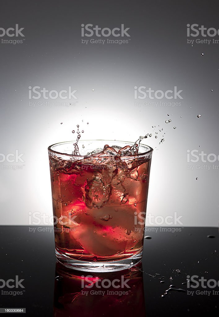 Ice dropping into drink. royalty-free stock photo