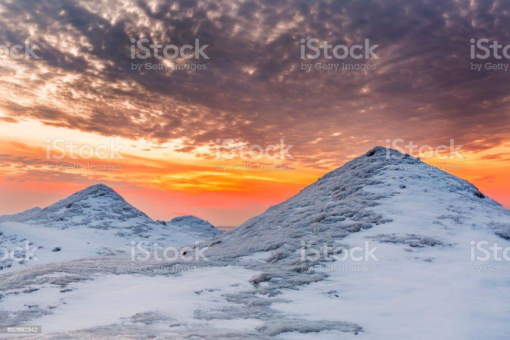 Ice Dunes on a Lake Huron Shoreline at Sunset stock photo