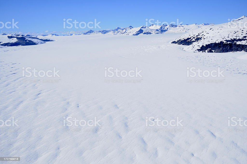 Ice field and mountains royalty-free stock photo