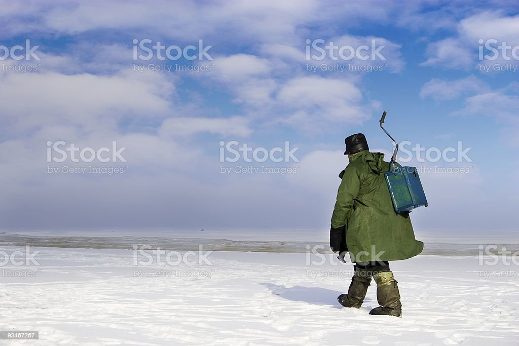 Ice Fisherman going away royalty-free stock photo