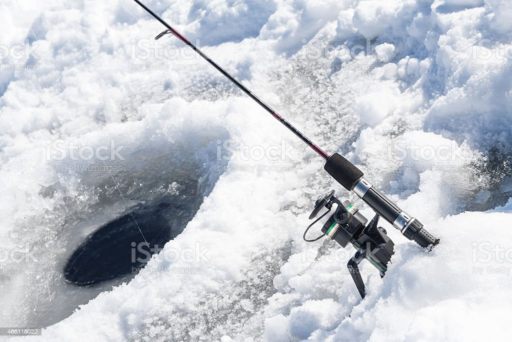 Ice Fishing Hole with Fishing Pole stock photo