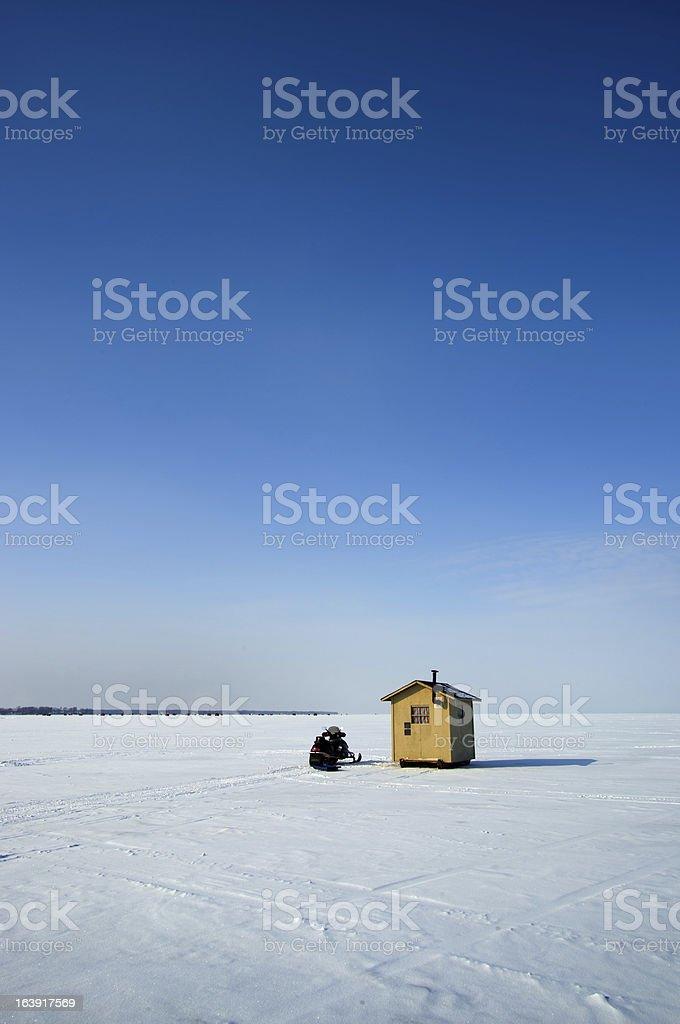Ice fishing hut on a lake stock photo