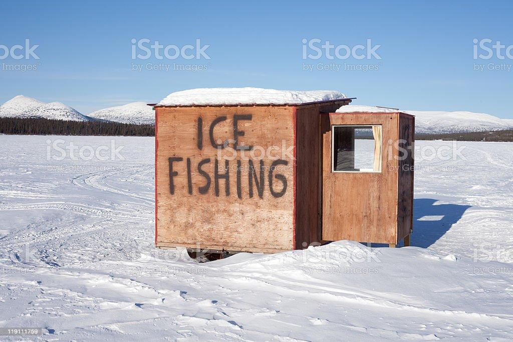 Ice fishing hut stock photo