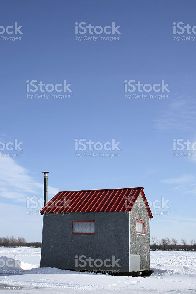 Ice fishing hut under the blue sky royalty-free stock photo