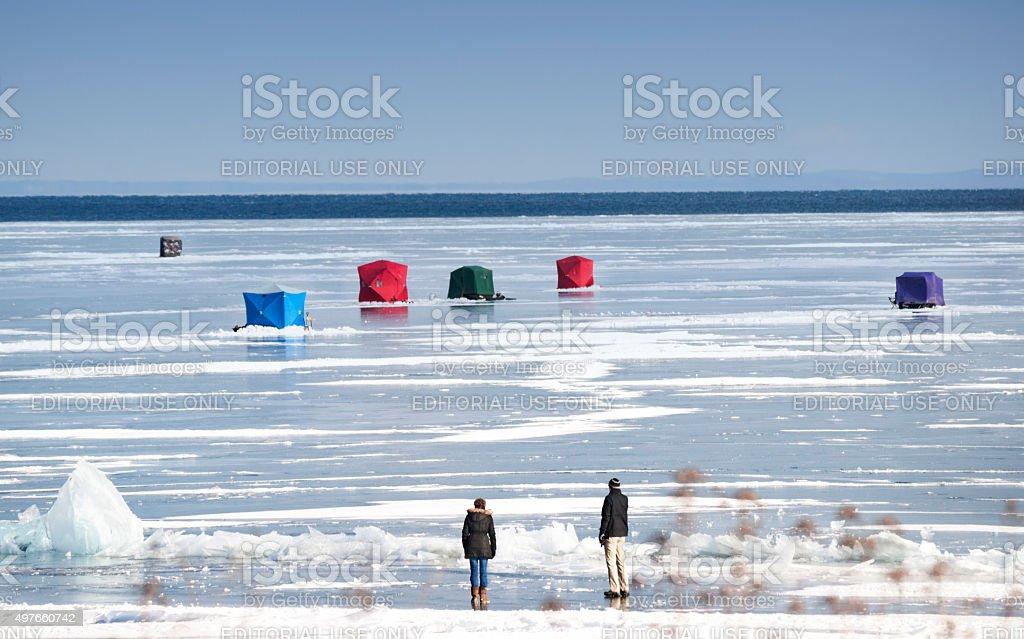 Ice fishing huts on Lake Superior stock photo