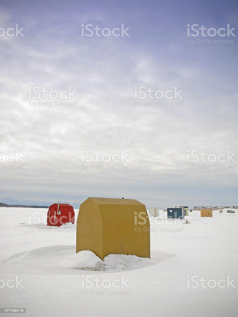 Ice fishing huts. stock photo