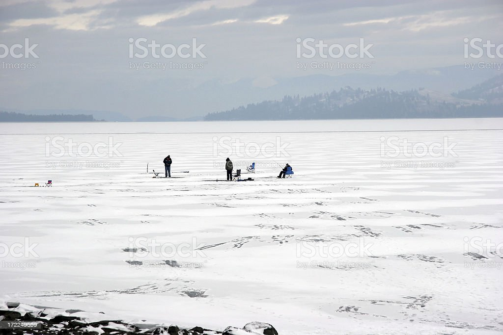 Ice Fishing  Landscape On A Montana Lake stock photo