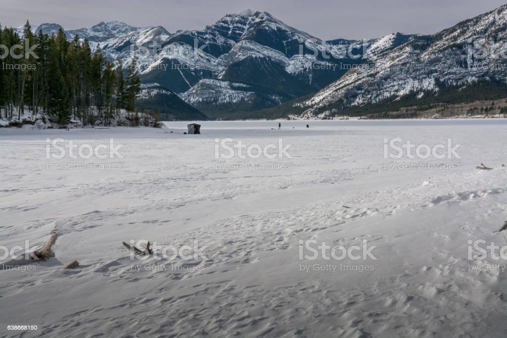 Ice Fishing on a Mountain Lake stock photo