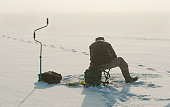 Ice fishing on the lake.