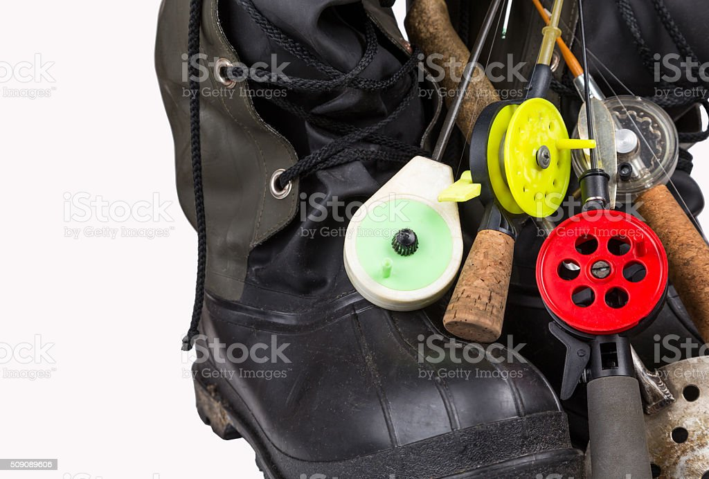 ice fishing tackles and winter boots stock photo