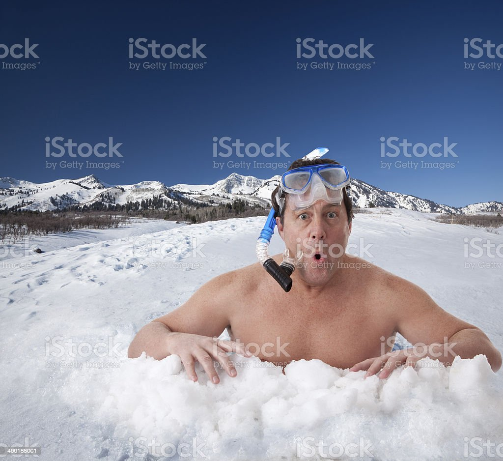 Ice Fishing With Snorkel Gear stock photo