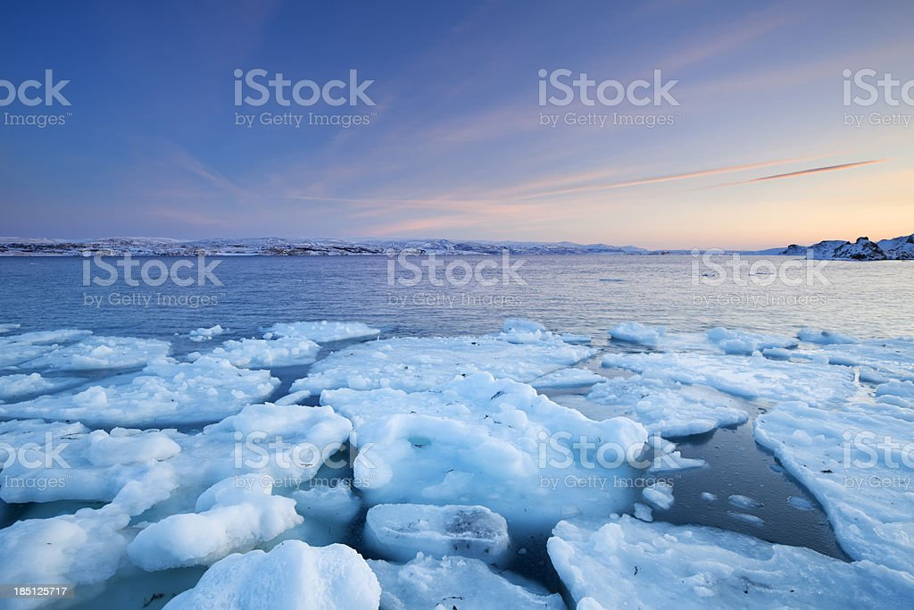 Ice floes at sunset, Arctic Ocean, Porsangerfjord, Norway stock photo