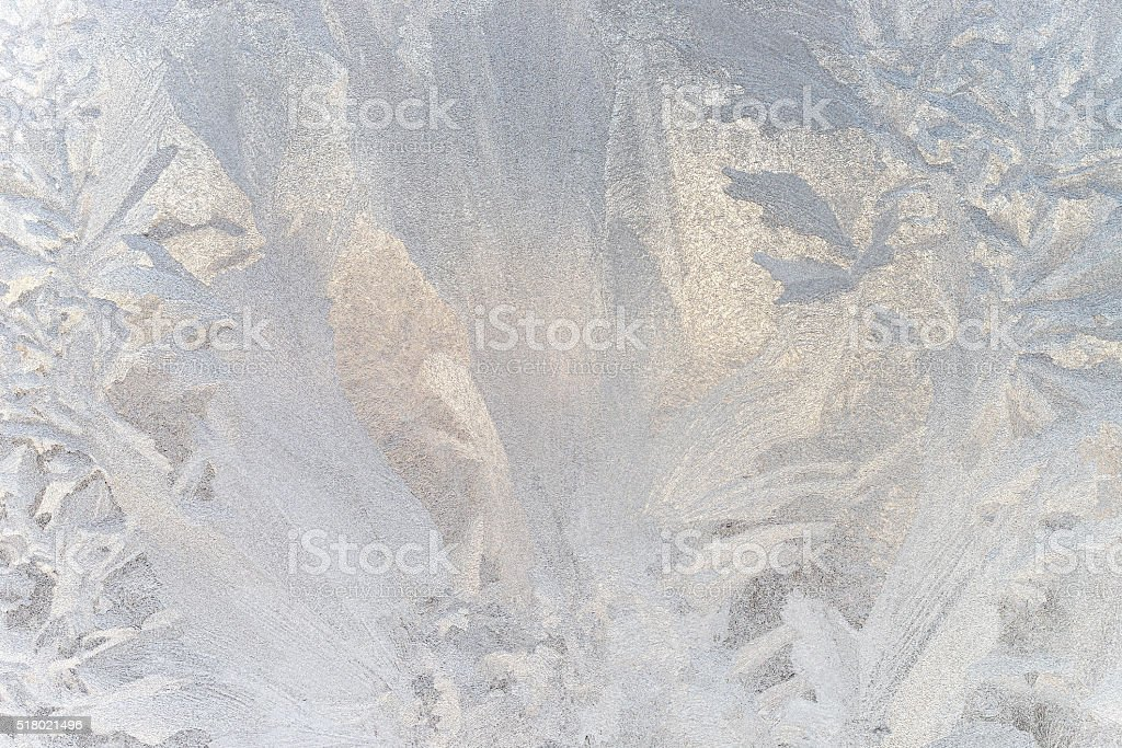 Ice floral pattern on glass in blurred vignette. Macro view. stock photo