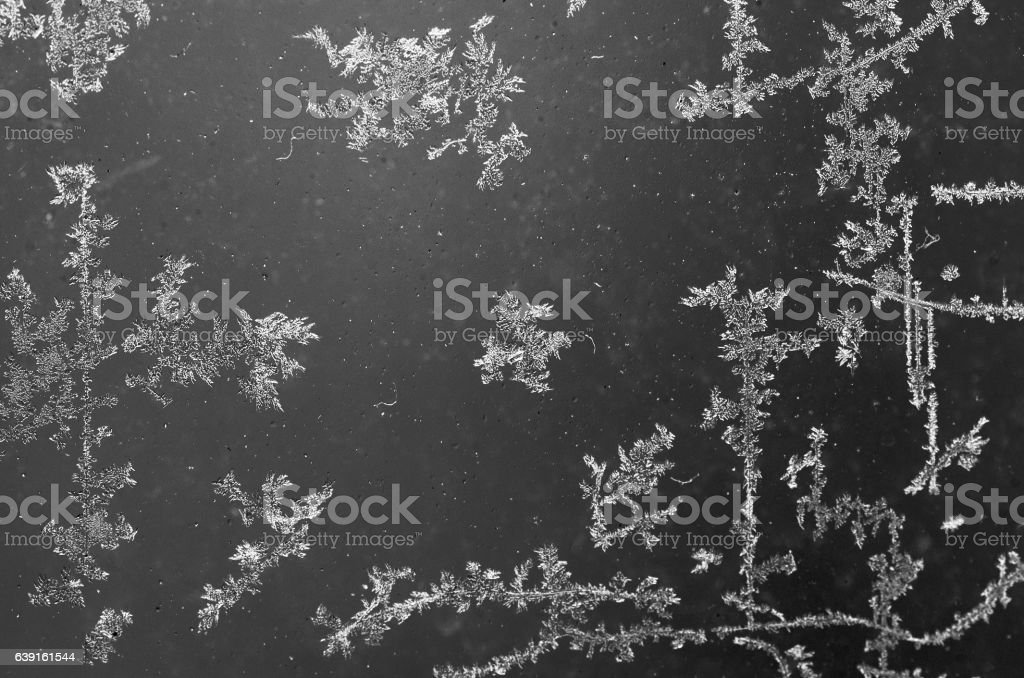 Ice flowers on glass texture stock photo