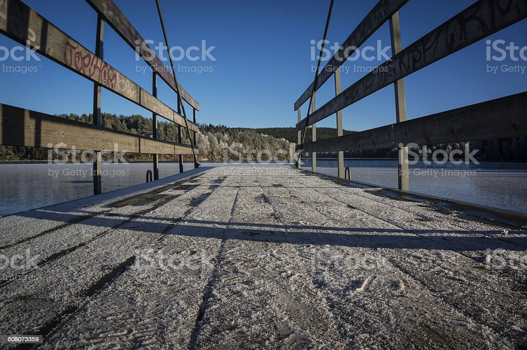 Ice frozen pier at Norwgian lake royalty-free stock photo