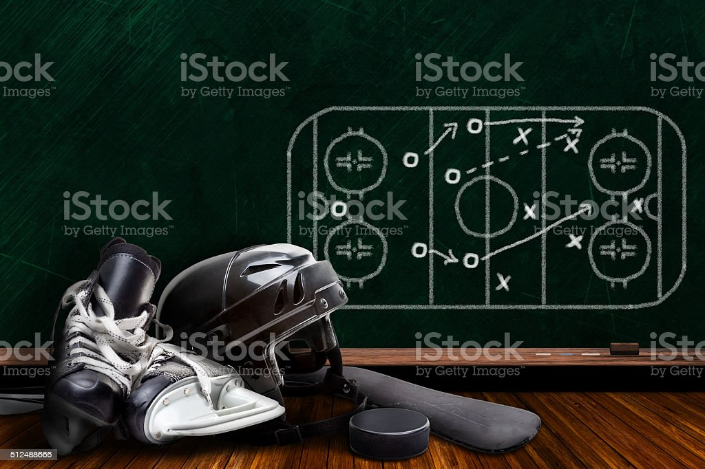 Ice Hockey Equipment and Chalk Board Play Strategy stock photo