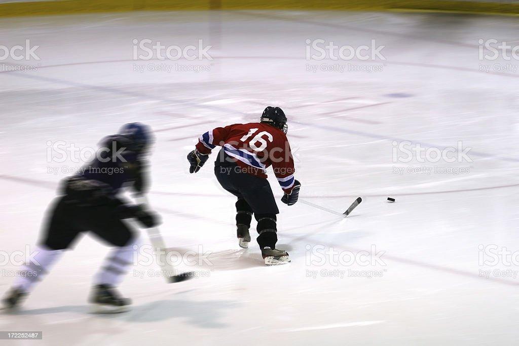 Ice hockey game action shot stock photo