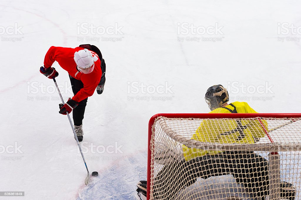 Ice Hockey Goalie Defending at Penalty Shot stock photo