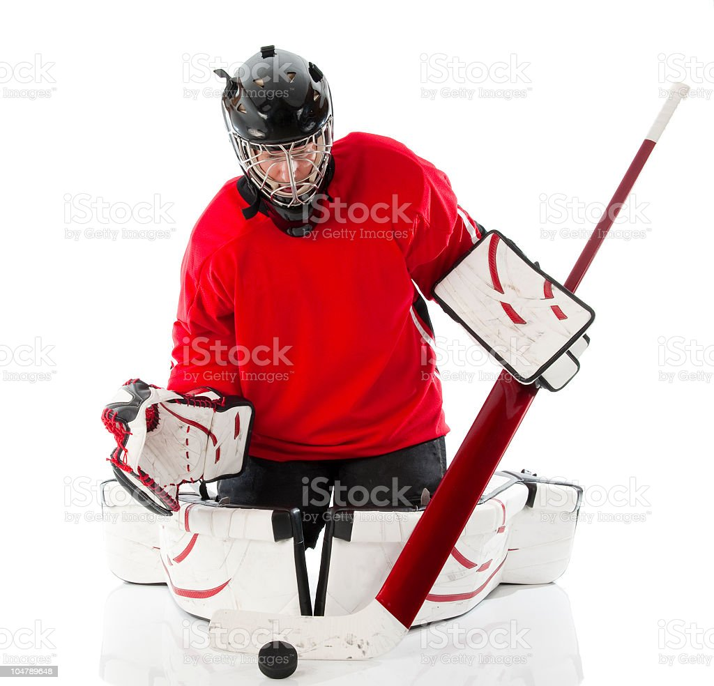 Ice hockey goalie with full gear and disc royalty-free stock photo