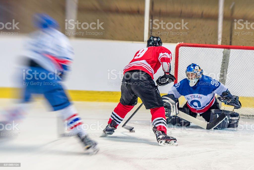 Ice hockey goalkeeper defending goal stock photo