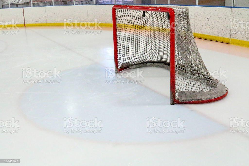 Ice hockey net pointing left and goalie crease stock photo