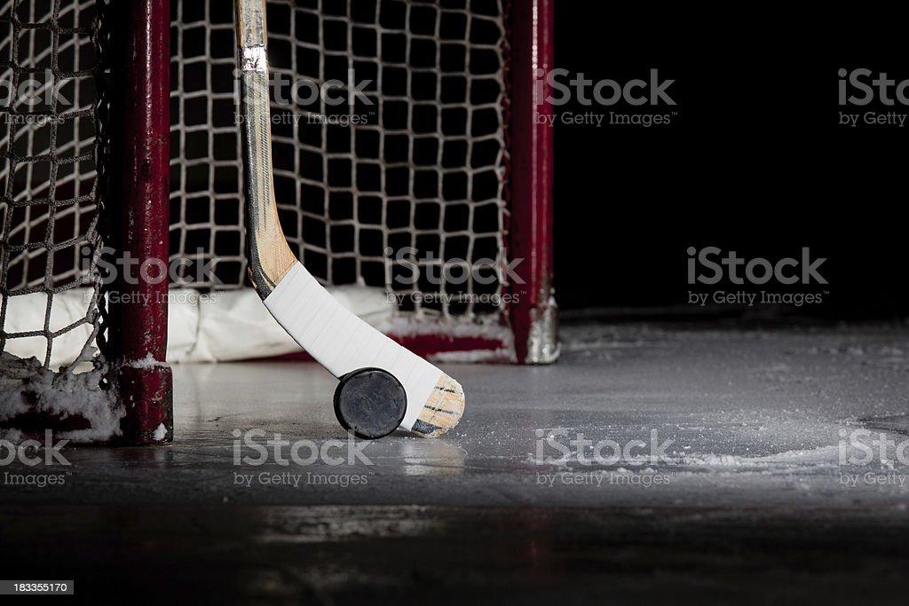 Ice Hockey Net, Puck, and Stick stock photo