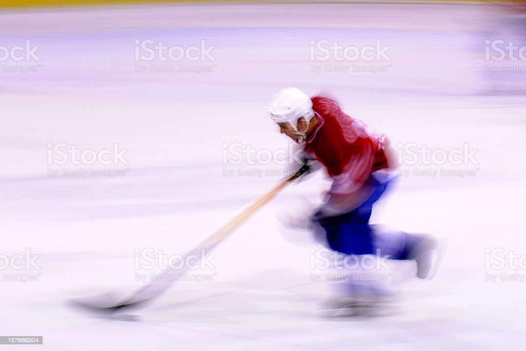 Ice hockey player in the action royalty-free stock photo