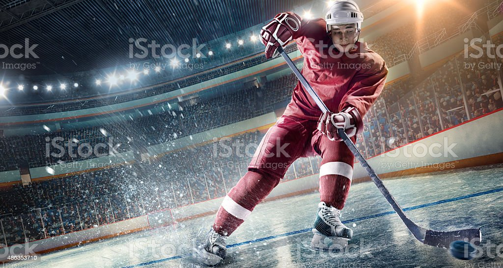 Ice Hockey Player on Hockey Arena stock photo