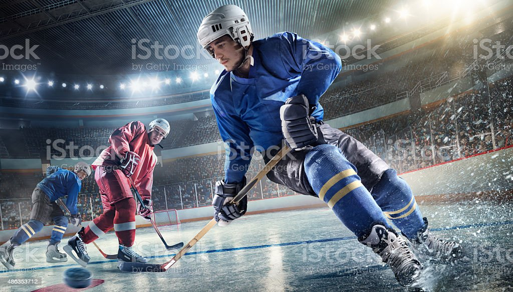 Ice Hockey Player on Hockey Arena stock photo