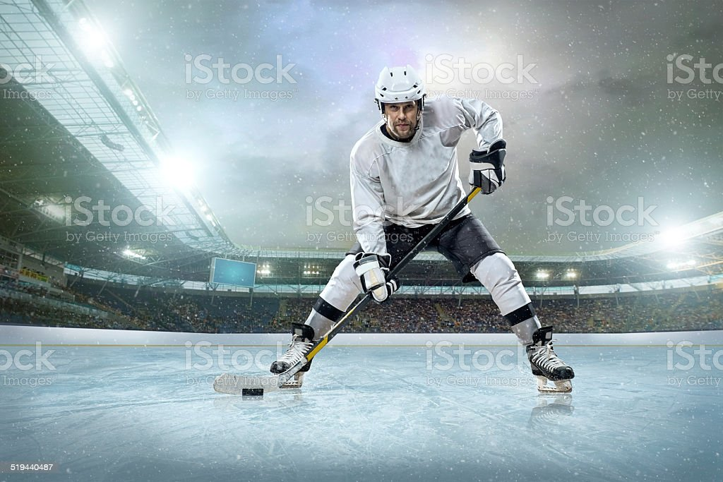 Ice hockey player on the ice. Open stadium stock photo
