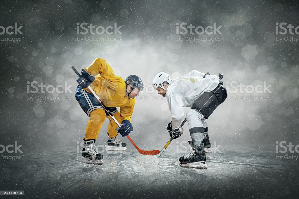 Ice hockey player on the ice, outdoors stock photo