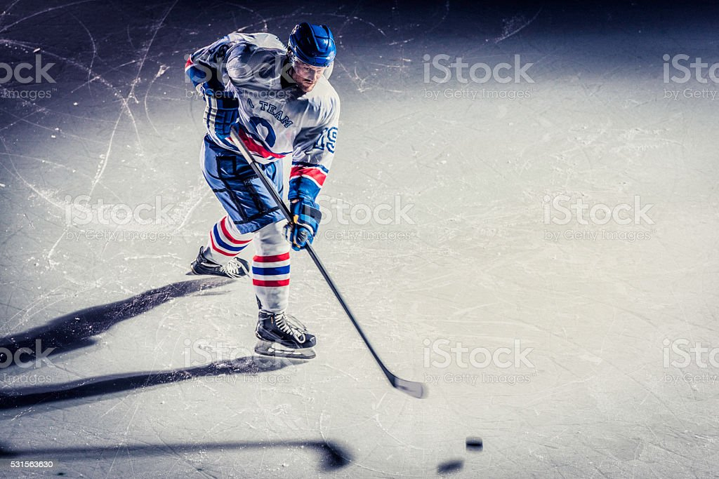 Ice hockey player on the ice, high angle view.