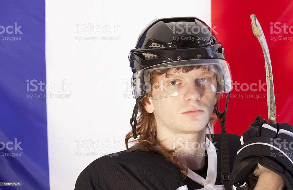 ice hockey player over france flag stock photo