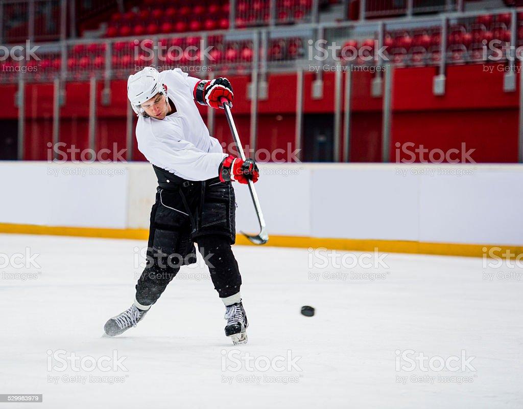 Ice Hockey Player Shooting at Goal stock photo