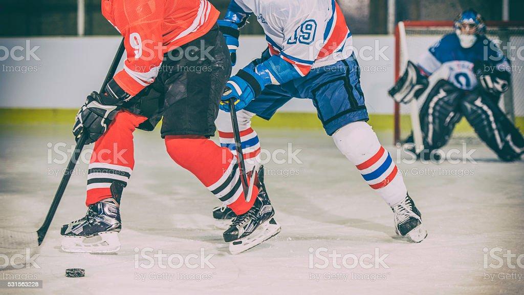 Ice hockey players duel stock photo