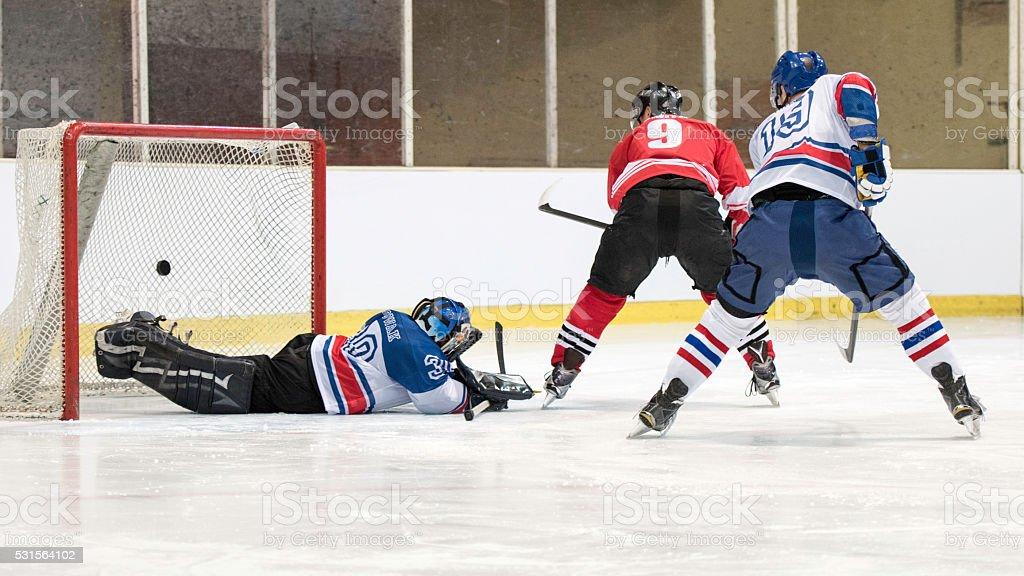Ice hockey players scoring goal stock photo