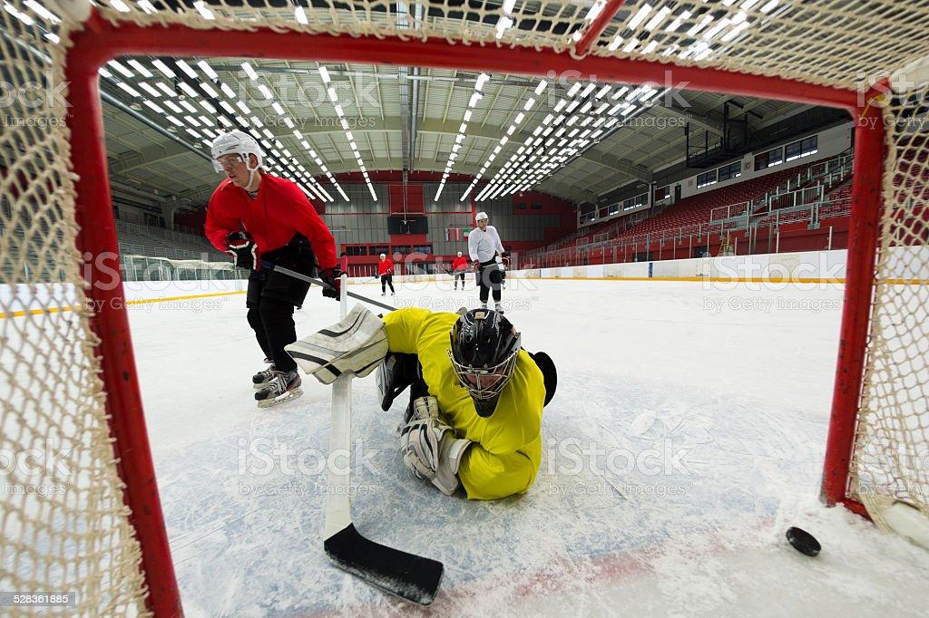 Ice Hockey Players Scoring the Goal stock photo