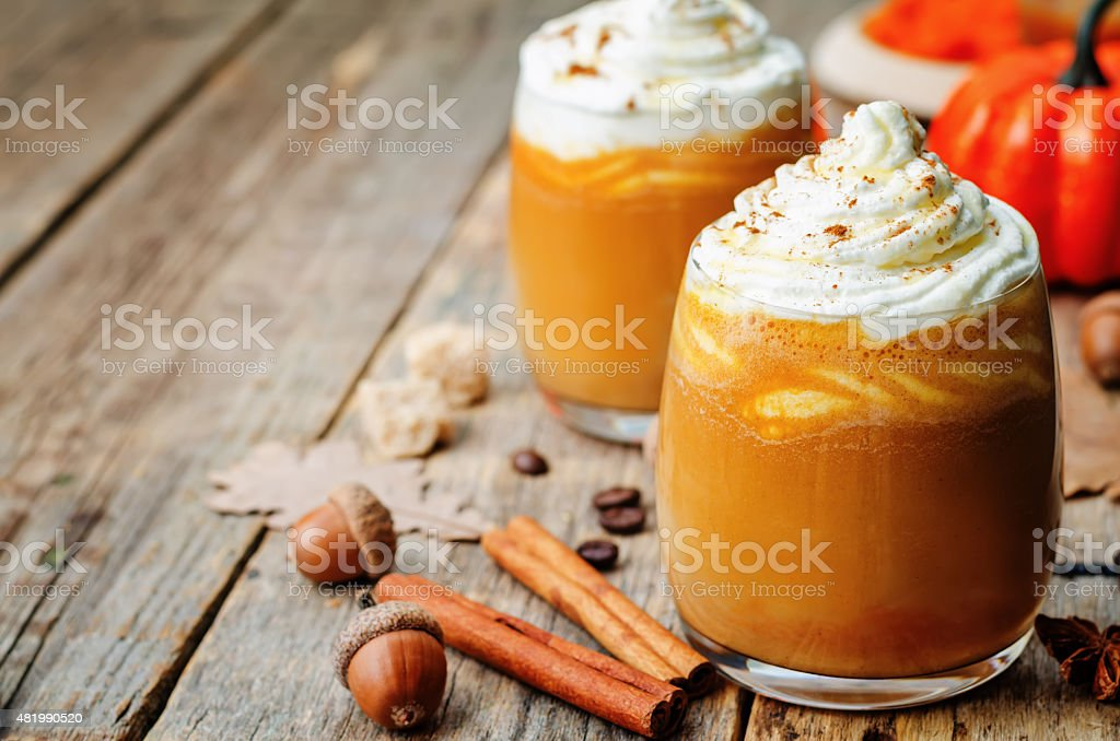 ice honey pumpkin spice latte with whipped cream stock photo
