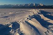 Ice hummocks of Lake Baikal and Holy Nose Peninsula.