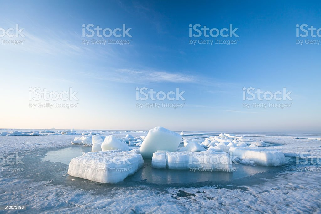 Ice hummocks swim in the sea stock photo