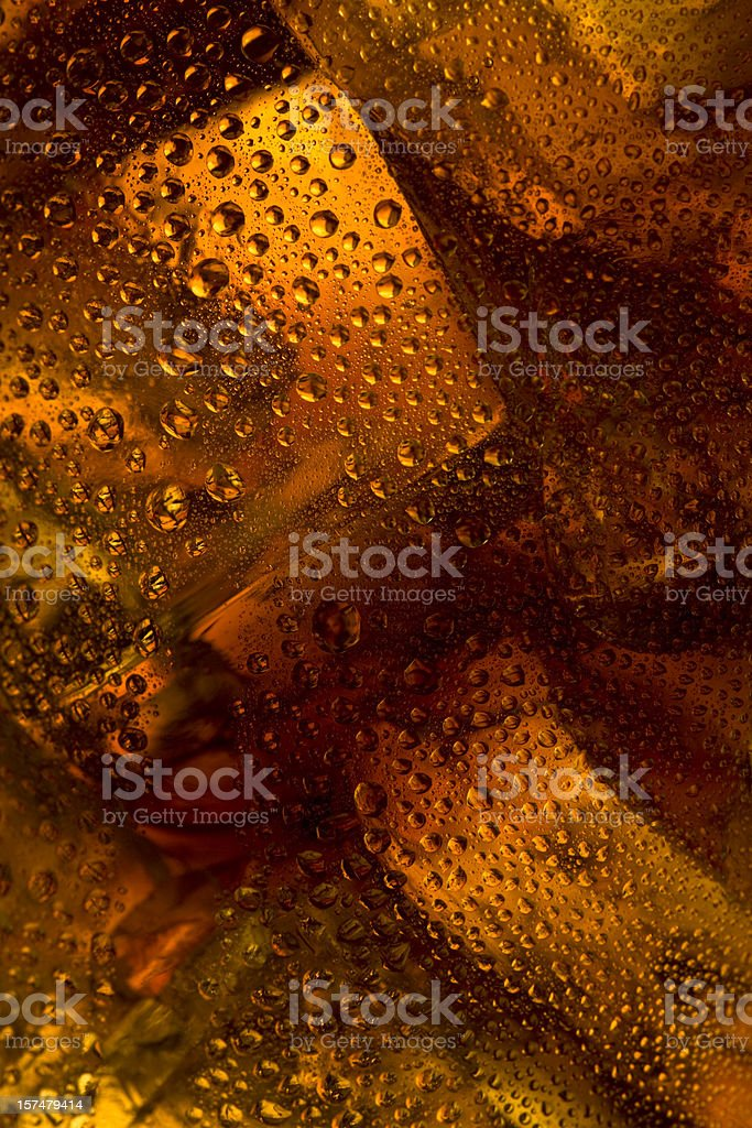 Ice in cola with condensation stock photo