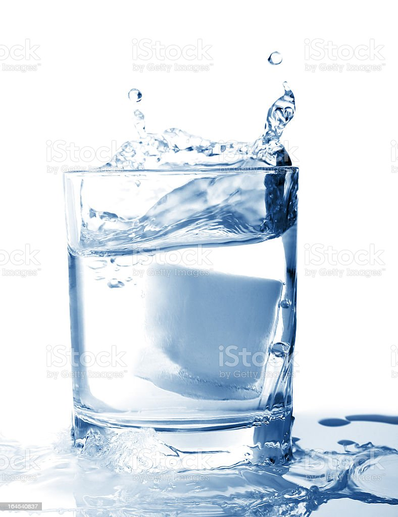 Ice in glass of water with splash royalty-free stock photo