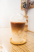 Ice latte in plastic cup.