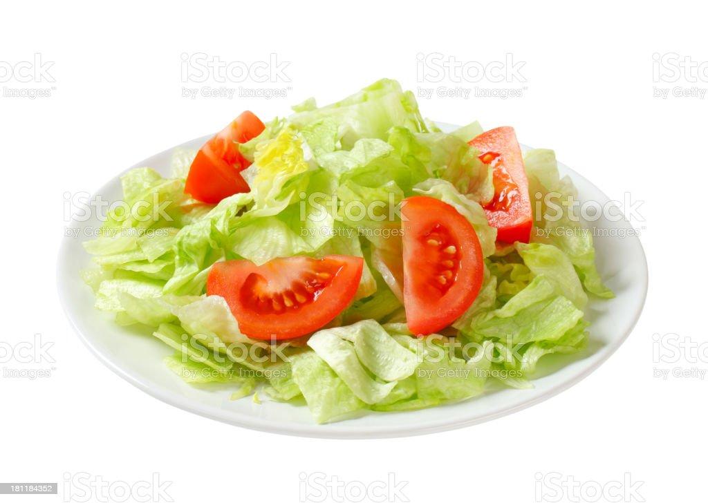 Ice lettuce and tomato wedges stock photo