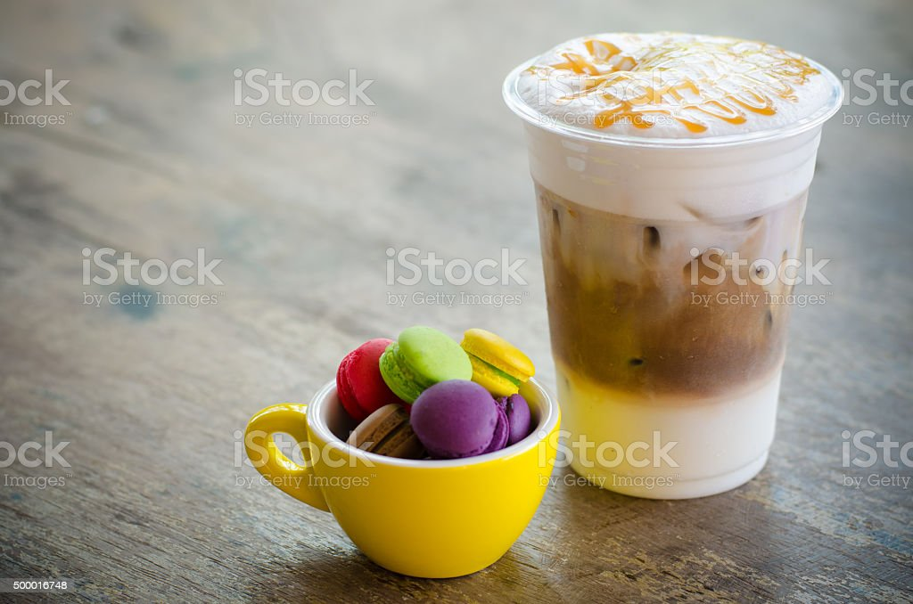 ice macchiato coffee and macaroons in cup stock photo