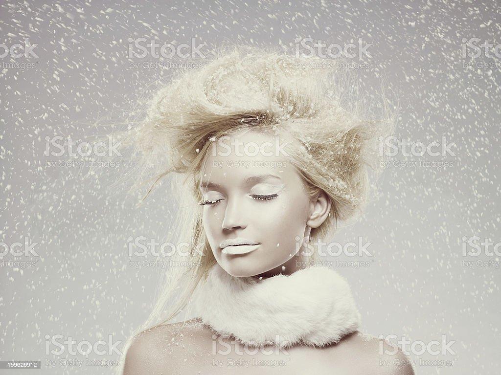 Ice maiden in snow stock photo