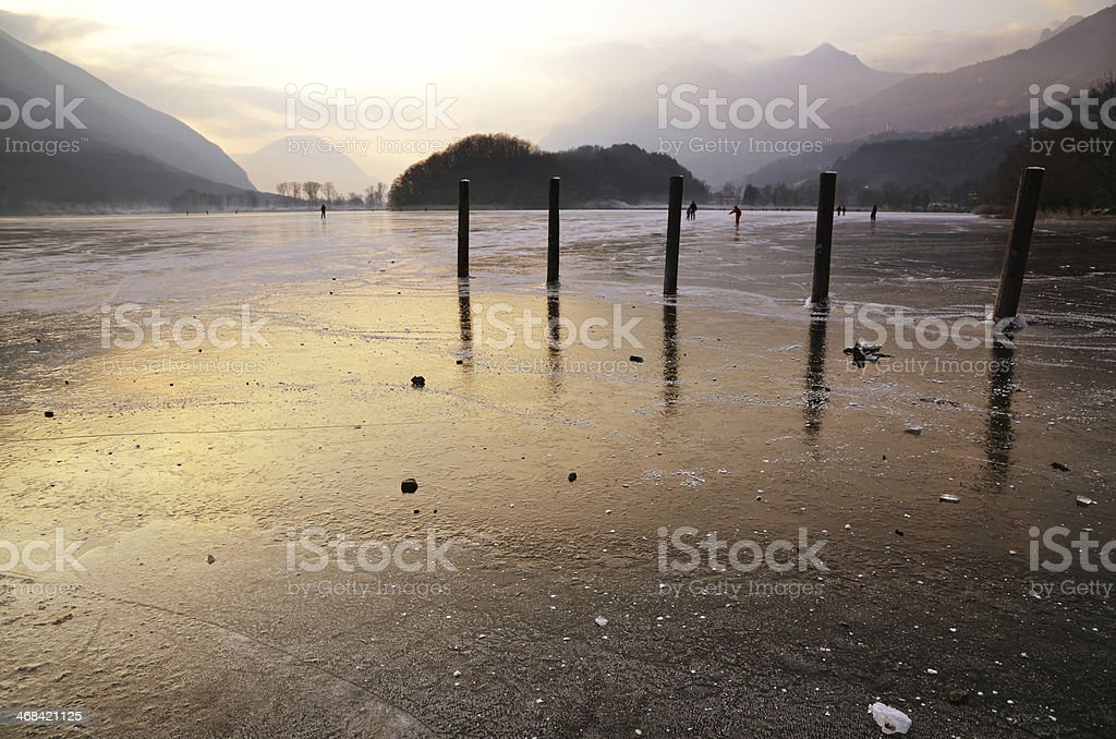 Ice on a lake in sunset stock photo