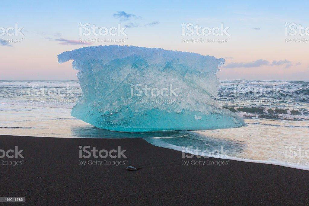 Ice on black sand beach blue sky stock photo