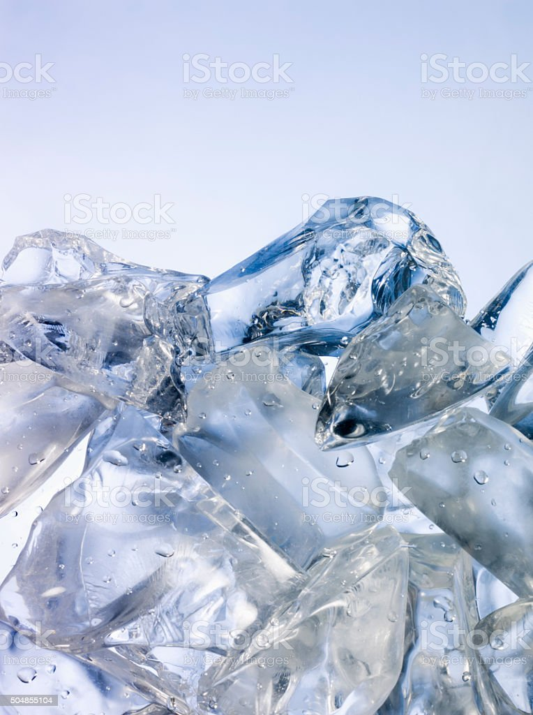 Ice on blue background stock photo