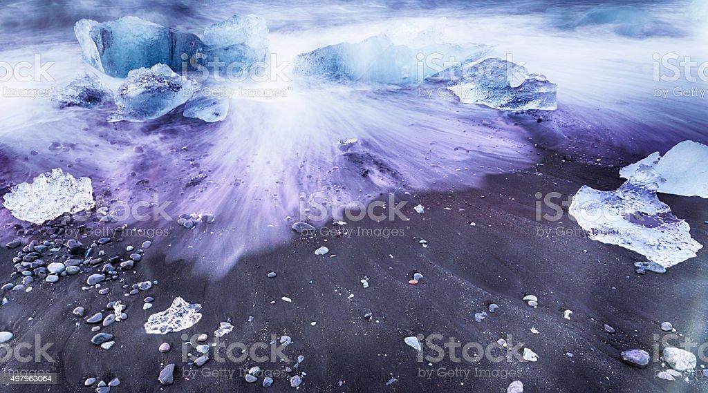 Ice on the Beach - Sunrise at Joksulsarlon Iceland stock photo